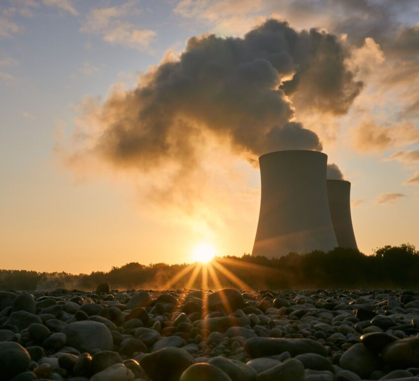 low-angle-photo-of-nuclear-power-plant-buildings-emtting-3044470